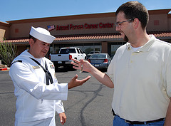 Man giving keys to a navy officer
