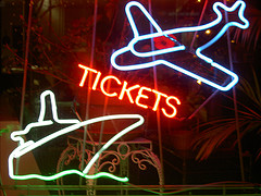 Neon sign of a travel agency