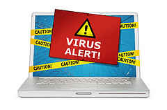 Virus alert note over an open laptop